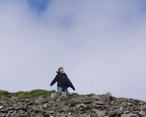 Student atop Medb's Cairn during study-abroad trip in Ireland